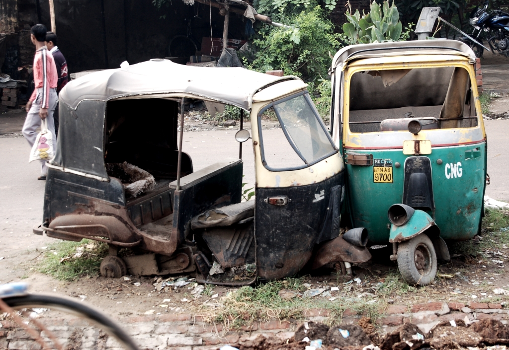 Battered autorickshaws in India. Photo by Guy Bergstrom.