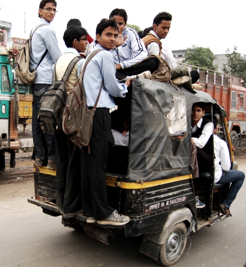 I counted about 15 students inside, on top or hanging from the back of this auto-rickshaw. It's the Indian version of a cab, with three wheels and a lot more excitement than boring Yellow Cabs back home. With the right driver, an autorickshaw ride can be like a Formula One race through side streets and packed traffic. Photo by Guy Bergstrom.