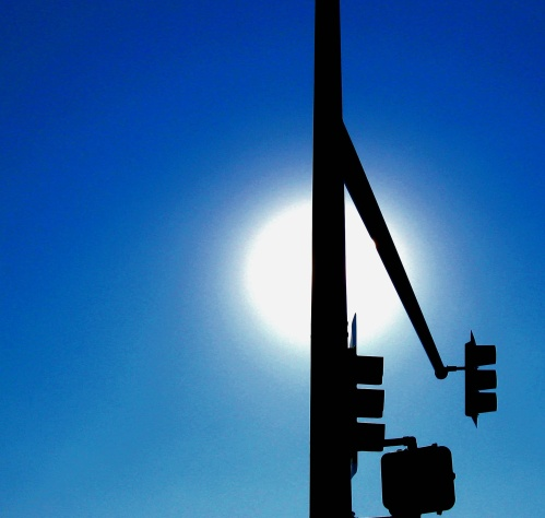 This is just a stop sign in Denver and the sun. But somehow, it's more than that. Photo by Guy Bergstrom.
