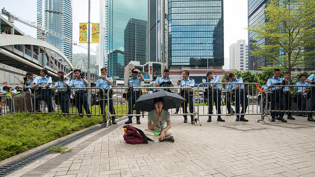Long protester in Hong Kong takes part in the Umbrella Revolution. Flickr photo by Doctor Ho.