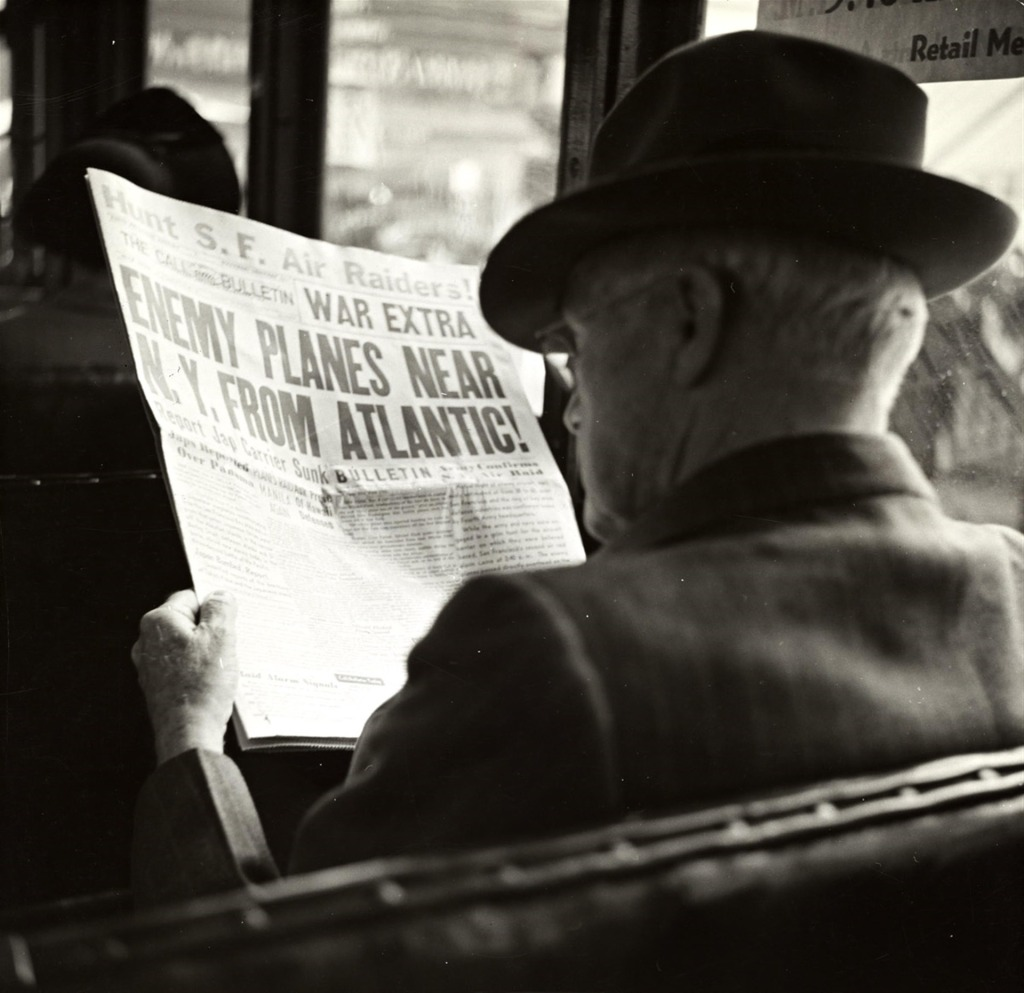 Man with newspaper